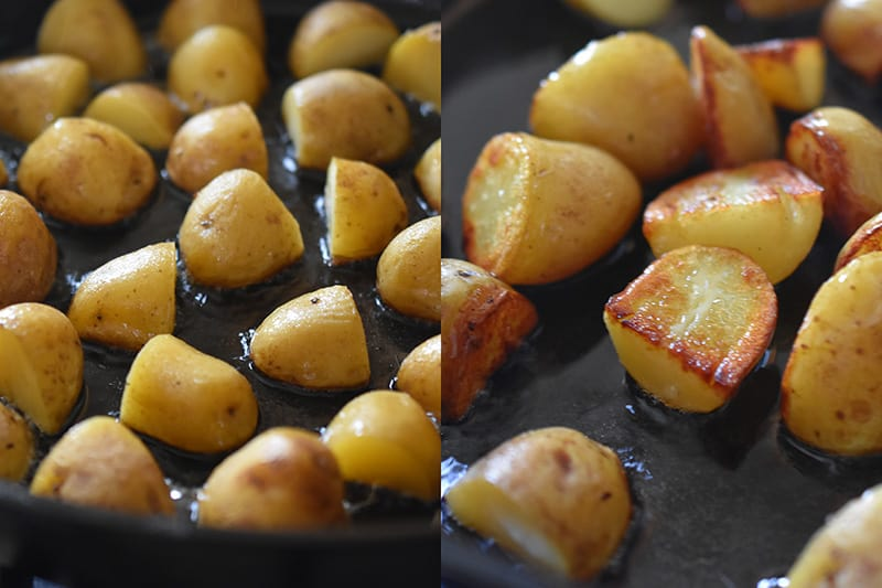 Frying the cooked potatoes in a cast iron skillet until crispy.