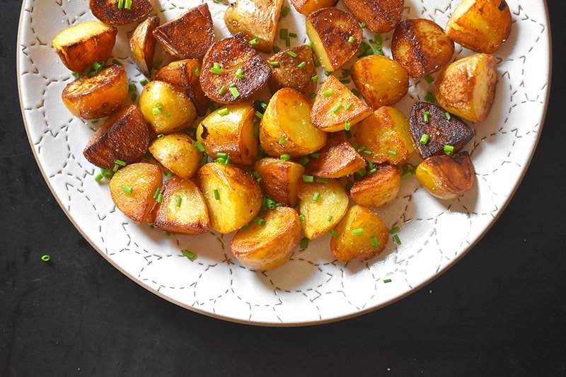 An overhead shot of Instant Pot (Pressure Cooker) Crispy Potatoes on a white platter