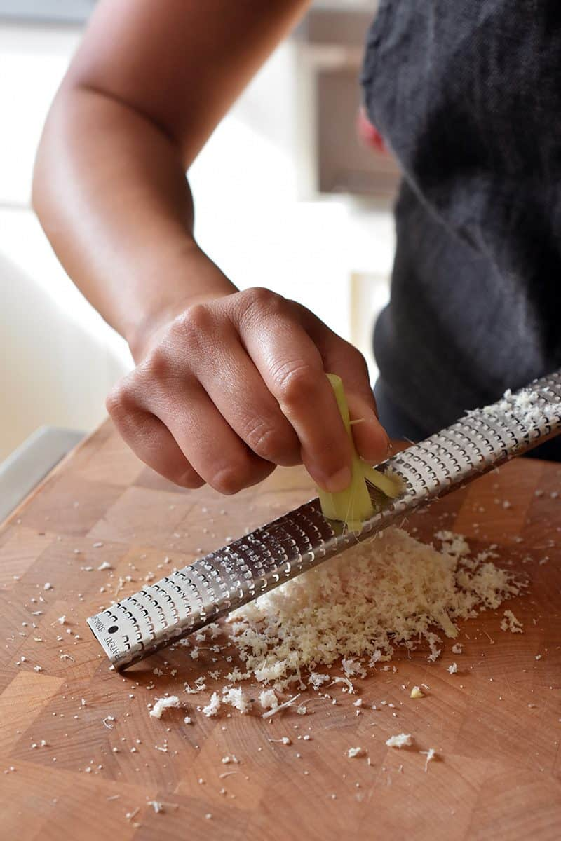 Using a microplane rasp grater to finely cut lemongrass.