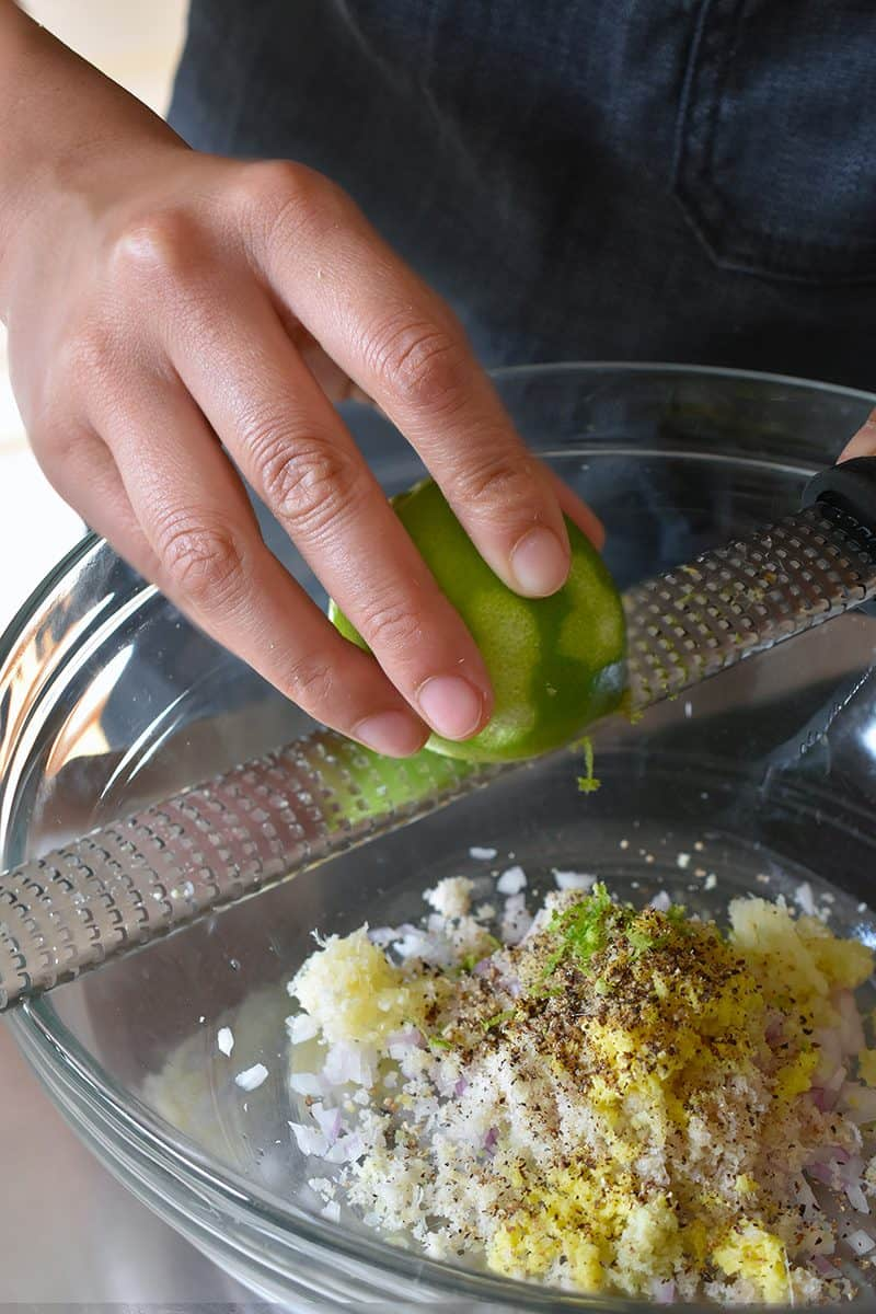 Zesting a lime for the Vietnamese Lemongrass Chicken marinade