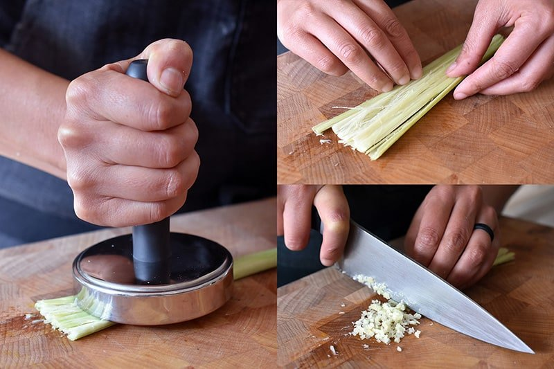 Smashing a piece of lemongrass with a meat pounder before mincing with a kitchen knife.
