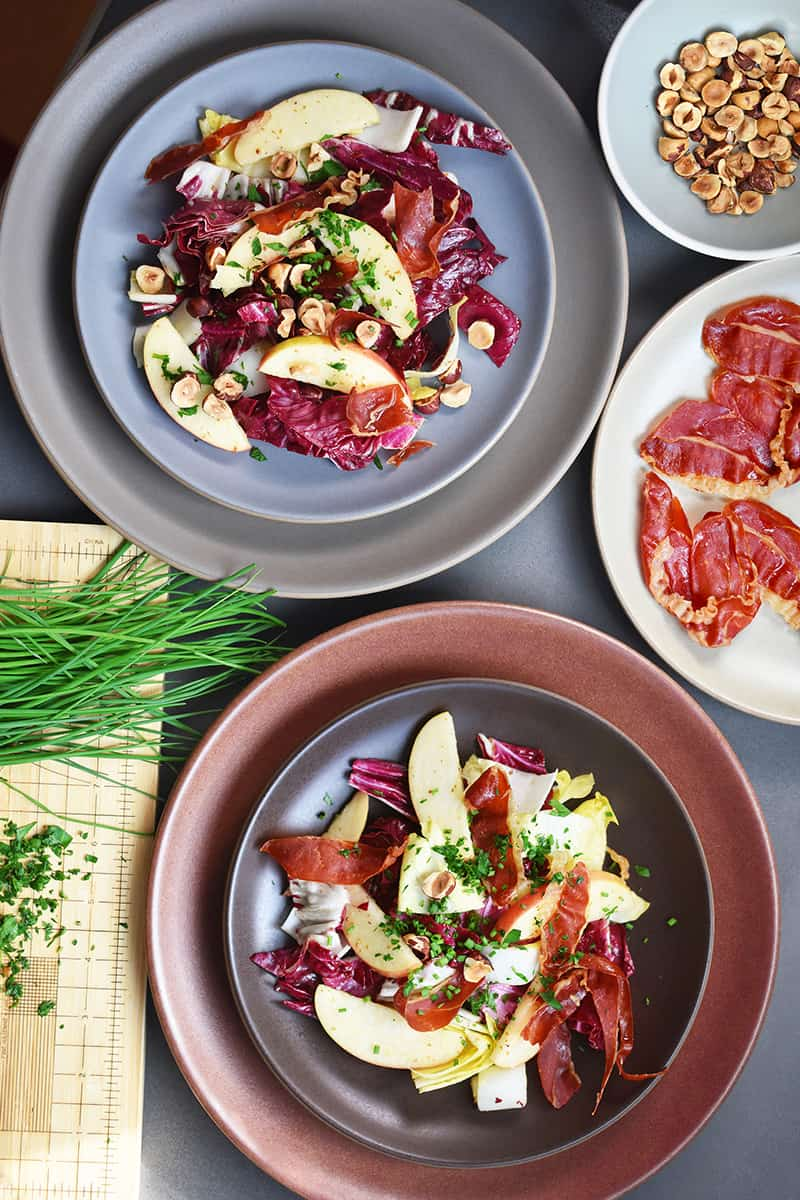 Endive, Radicchio, and Apple Salad with Porkitos and Hazelnuts by Michelle Tam https://nomnompaleo.com