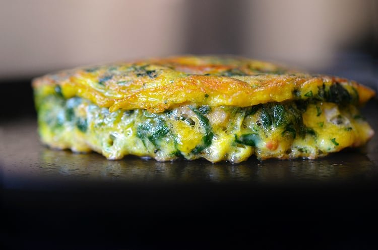 A side view of Egg Foo Young-ish (Spinach, Egg, Ham & Coconut Pancakes) on a plate.