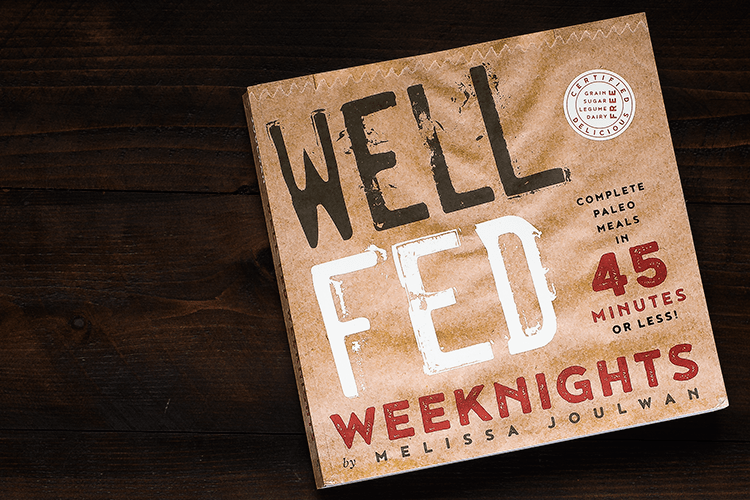 A close-up of the cookbook cover for Well Fed Weeknights.