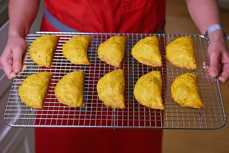 Paleo Curried Meat Pies on a cooling rack.