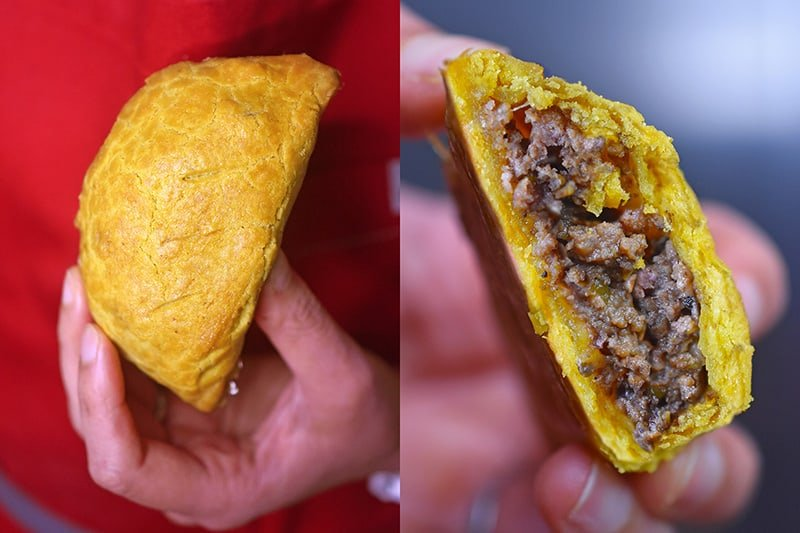 A Paleo Curried Meat Pie with a big bite taken out of it