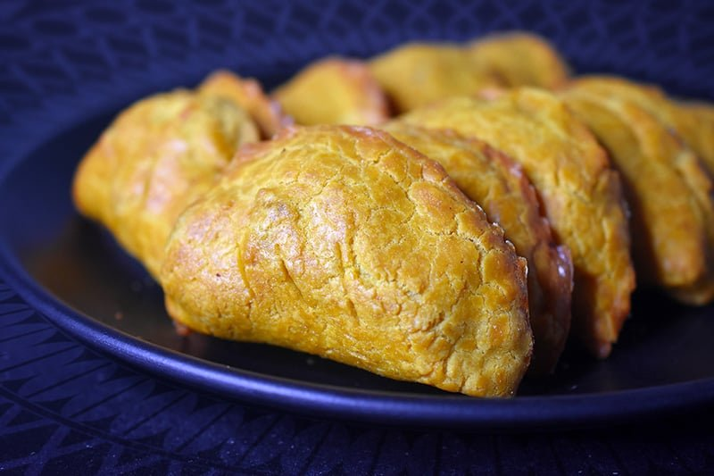A side view of a plate filled with Paleo Curried Meat Pies