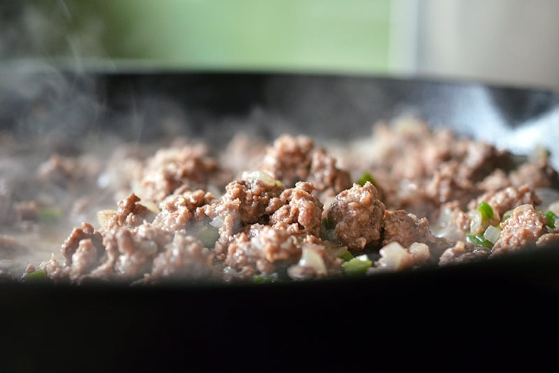 Cooked ground beef in a pan for paleo deconstructed samosa.