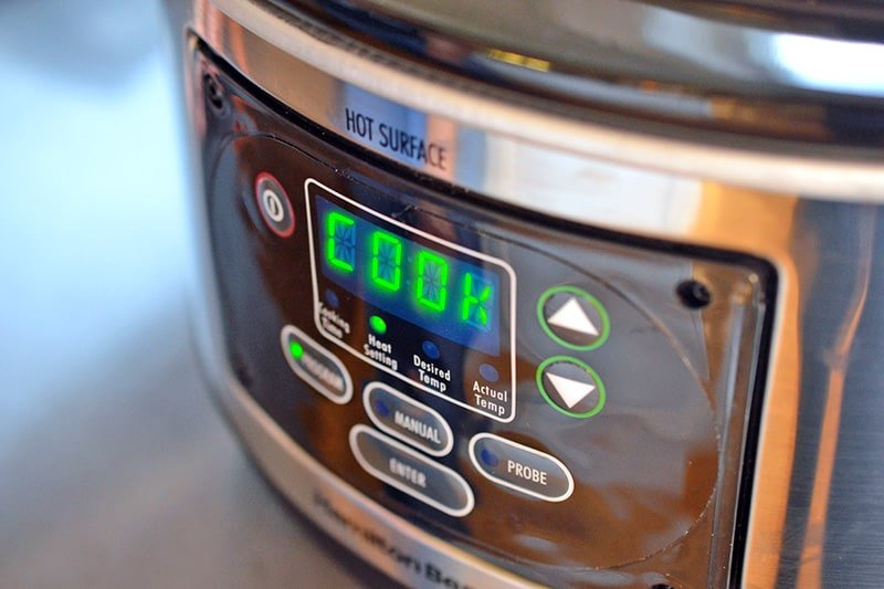 A closeup shot of the front of a slow cooker