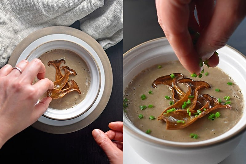 Someone garnishing the Instant Pot cream of mushroom soup.