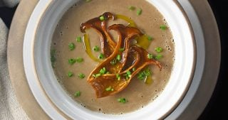 An overhead shot of a bowl of Instant Pot Cream of Mushroom Soup , a paleo, keto, and Whole30 soup!