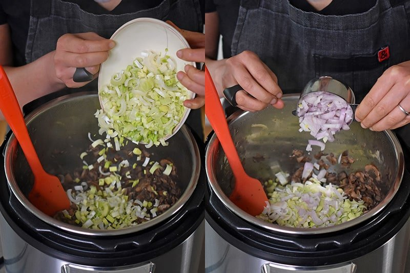 Someone tossing in diced leeks and shallots into the Instant Pot.