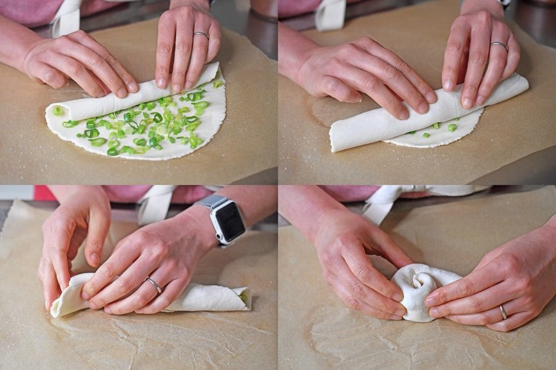 A four-step shot that shows someone rolling up the Paleo Scallion Pancake dough into a cigar shape and then wrapping it around like a cinnamon roll.