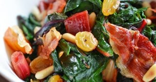 Swiss Chard with Raisins, Pine Nuts, and Porkitos by Michelle Tam / Nom Nom Paleo https://nomnompaleo.com