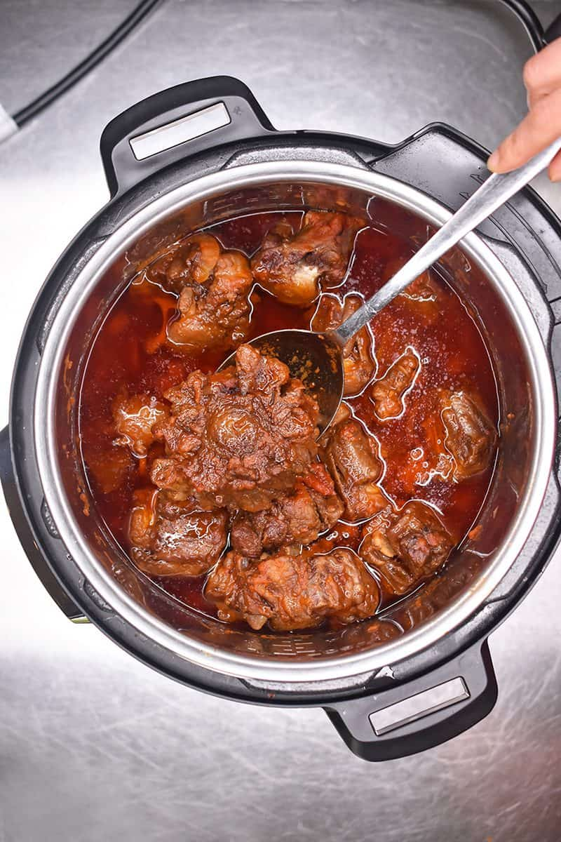 An overhead shot of an open Instant Pot filled with Instant Pot Oxtail Stew.