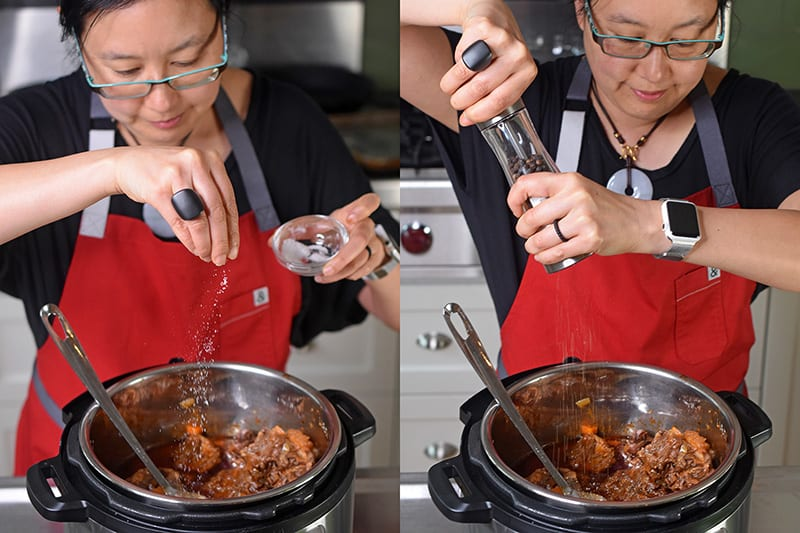 Michelle Tam is seasoning Instant Pot Oxtail Stew with salt and pepper.