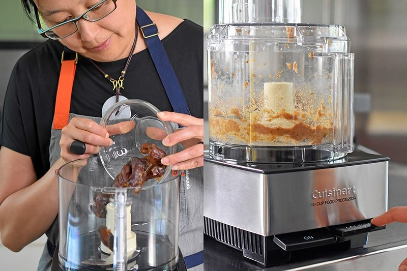 A woman in glasses is placing pitted medjool dates in a food processor to make No-Bake Matcha Cheesecake