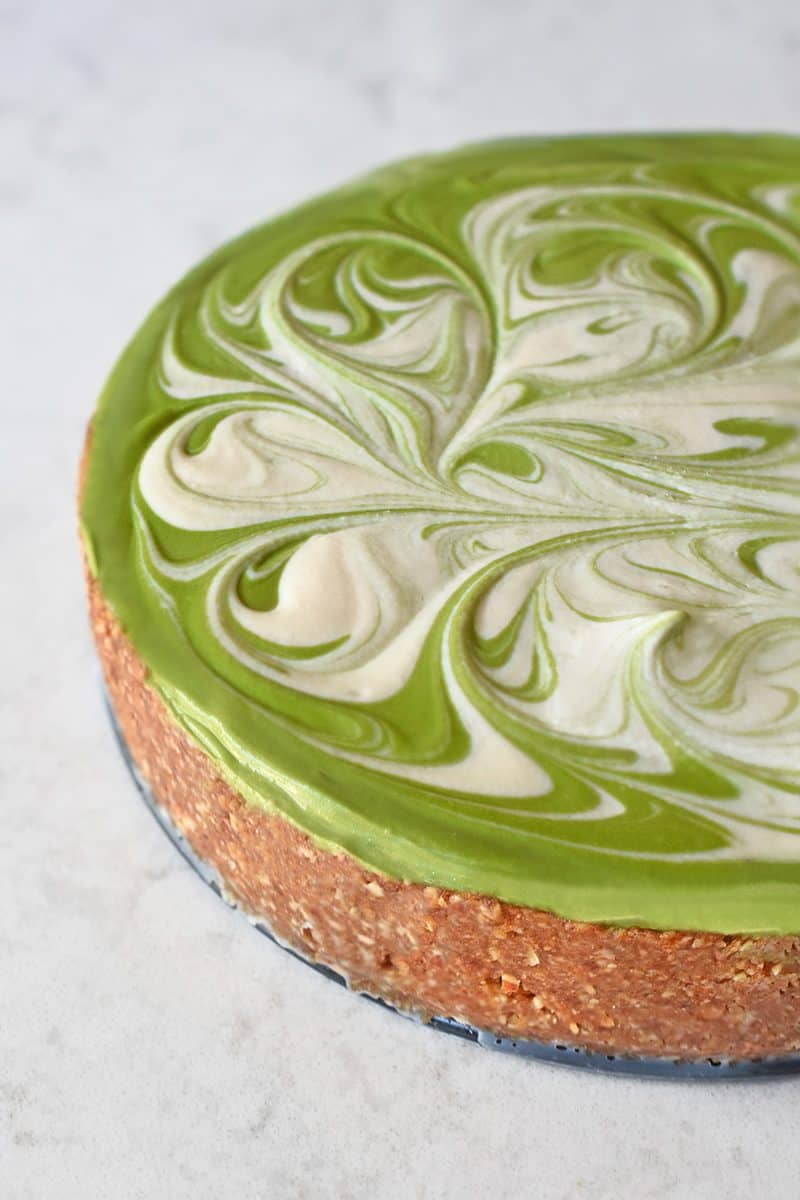 An overhead shot of paleo, vegan, dairy-free, and gluten-free No-Bake Matcha Cheesecake