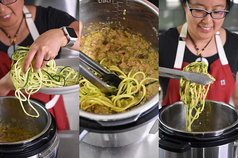 Raw zucchini noodles are added to Instant Pot Zucchini Bolognese to heat up.