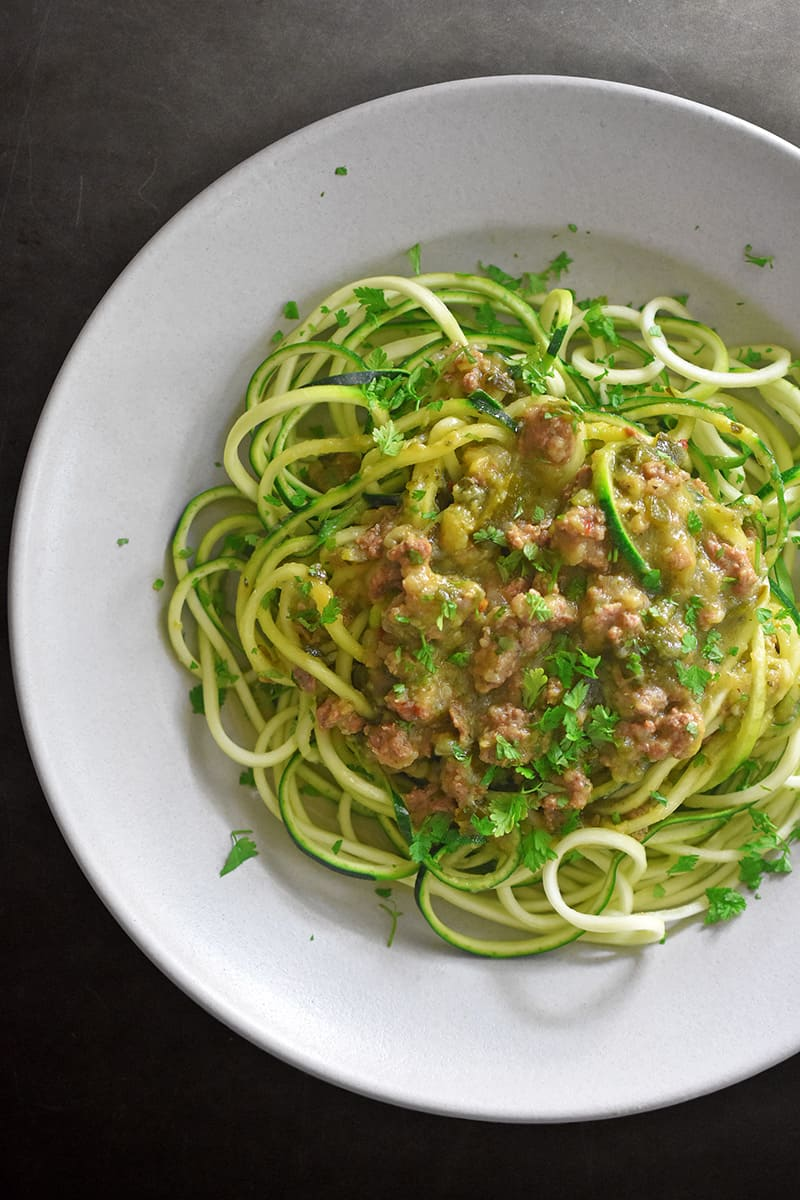 An overhead shot of a bowl of Instant Pot Zucchini Bolognese, a simple Whole30 and Paleo make-ahead dinner.
