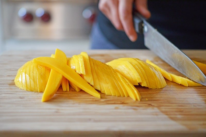 Spicy Mango Cabbage Slaw by Michelle Tam https://nomnompaleo.com