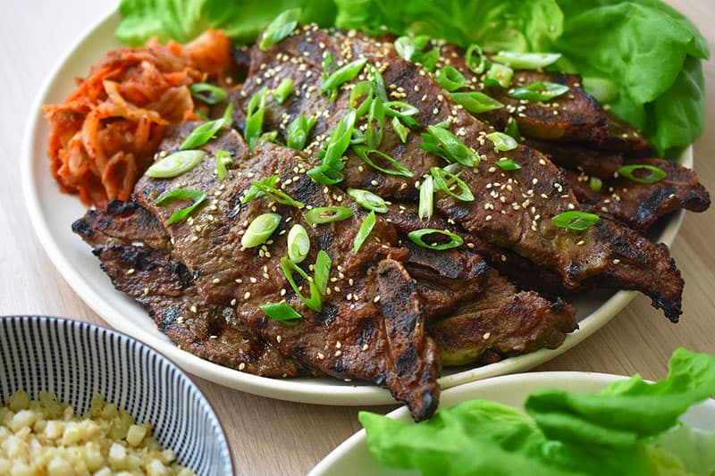 An overhead shot of Kalbi (Korean BBQ Short Ribs) that are Whole30 friendly and delicious