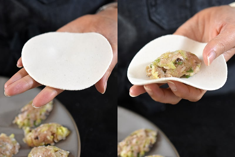 The pre-scooped oval-shaped Paleo Pot Sticker filling is placed in the middle the wrapper.