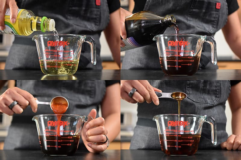 A liquid measuring cup is filled with rice vinegar, coconut aminos, sesame oil, and sriracha to make Paleo Pot Sticker dipping sauce.