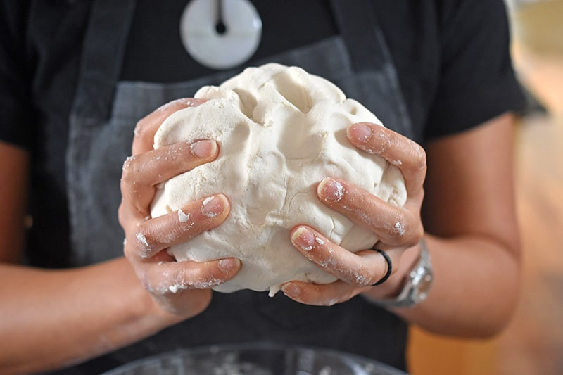 Handling a ball of wrapper dough for Paleo Pot Stickers