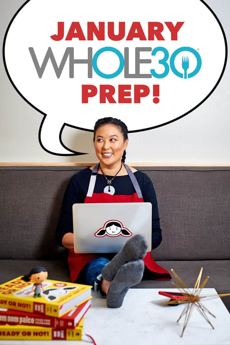 "A woman sitting on a couch with a computer on her lap and a word bubble that says, ""January Whole30 Prep!"""