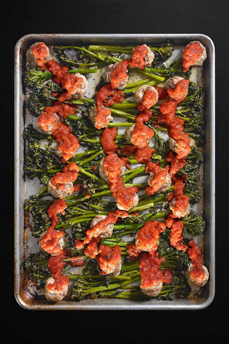 Overhead image of Sheet Pan Meatballs and Broccolini with marinara sauce