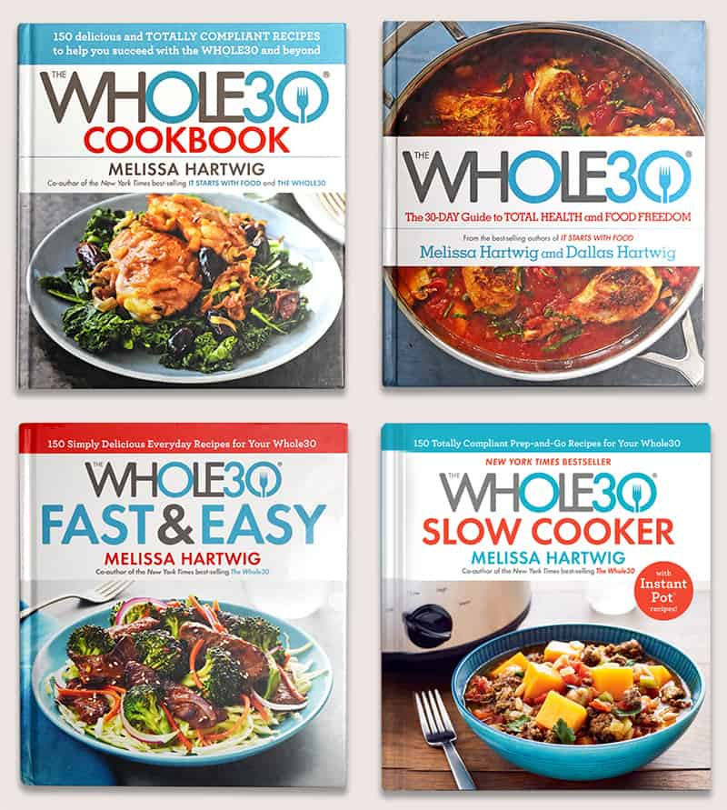A photo of all four Whole30 cookbooks.