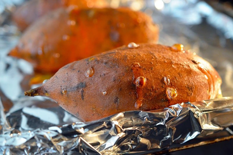 Close-up of baked sweet potatoes right out the oven.