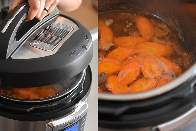 The Instant Pot is opened to show cooked sliced carrots floating on top of the Instant Pot Vietnamese Pork Stew cooking liquid.