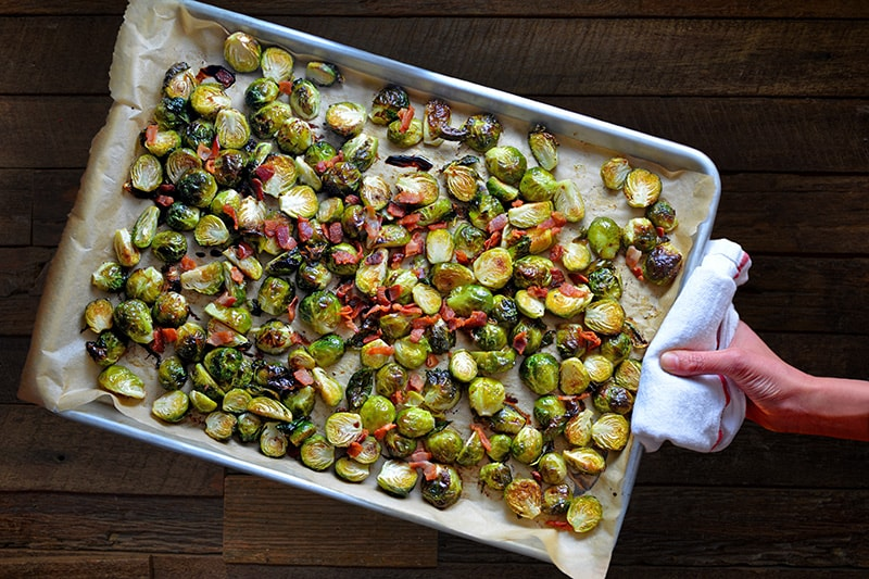 An overhead shot of a tray of Roasted Brussels Sprouts with Bacon
