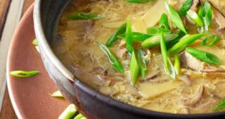 A closeup of paleo hot and sour soup in a bowl ready to be served.