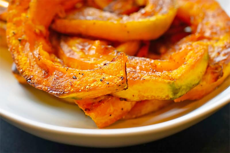 A plate filled with roasted kabocha squash.