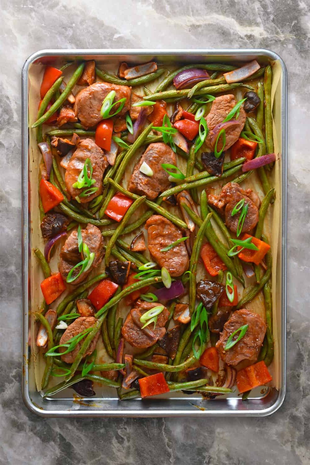 Overhead shot of sheet pan sweet and spicy pork.