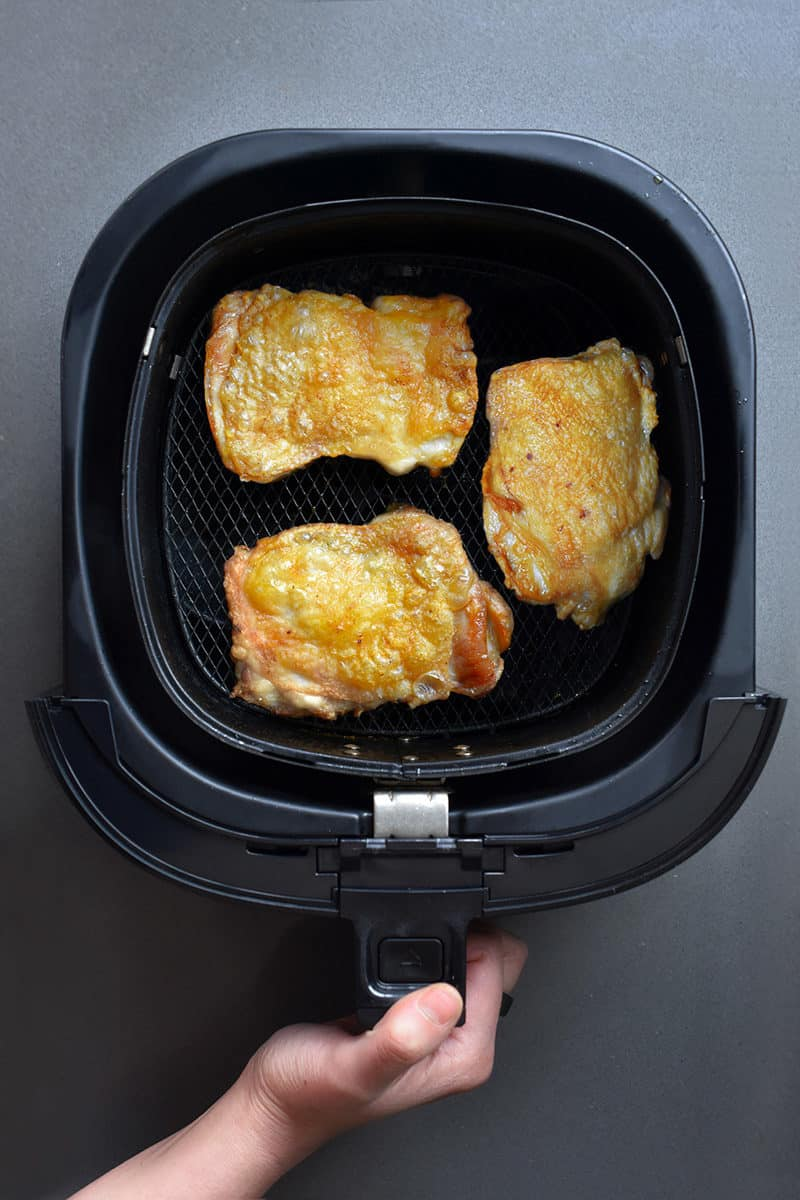 An overhead shot of Air Fryer Cracklin' Chicken in an air fryer basket.