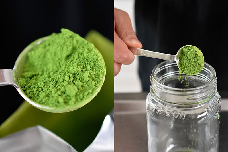 A closeup of a spoonful of bright green ceremonial matcha being added to an empty mason jar.
