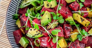 An overhead shot of a big bowl of paleo tuna poke with avocado.