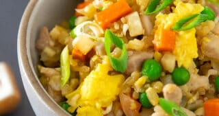 Close up shot of Cauliflower Chicken Fried Rice, a Whole30-friendly and healthy one-pan dinner.
