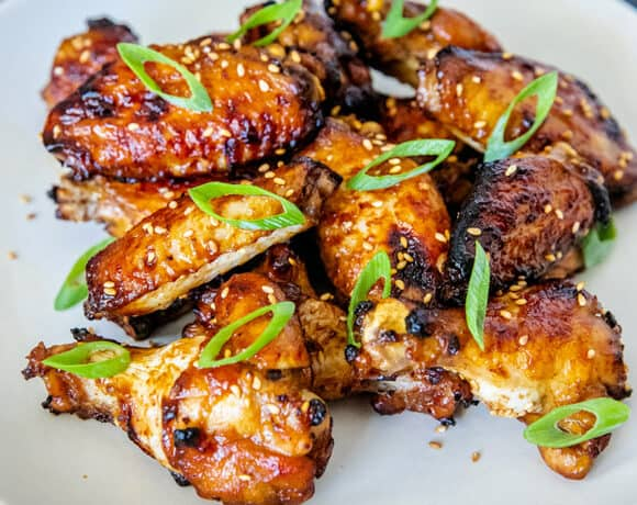 A white plate filled with Whole30, gluten-free, paleo Chinese Chicken Wings, a super easy game day appetizer!
