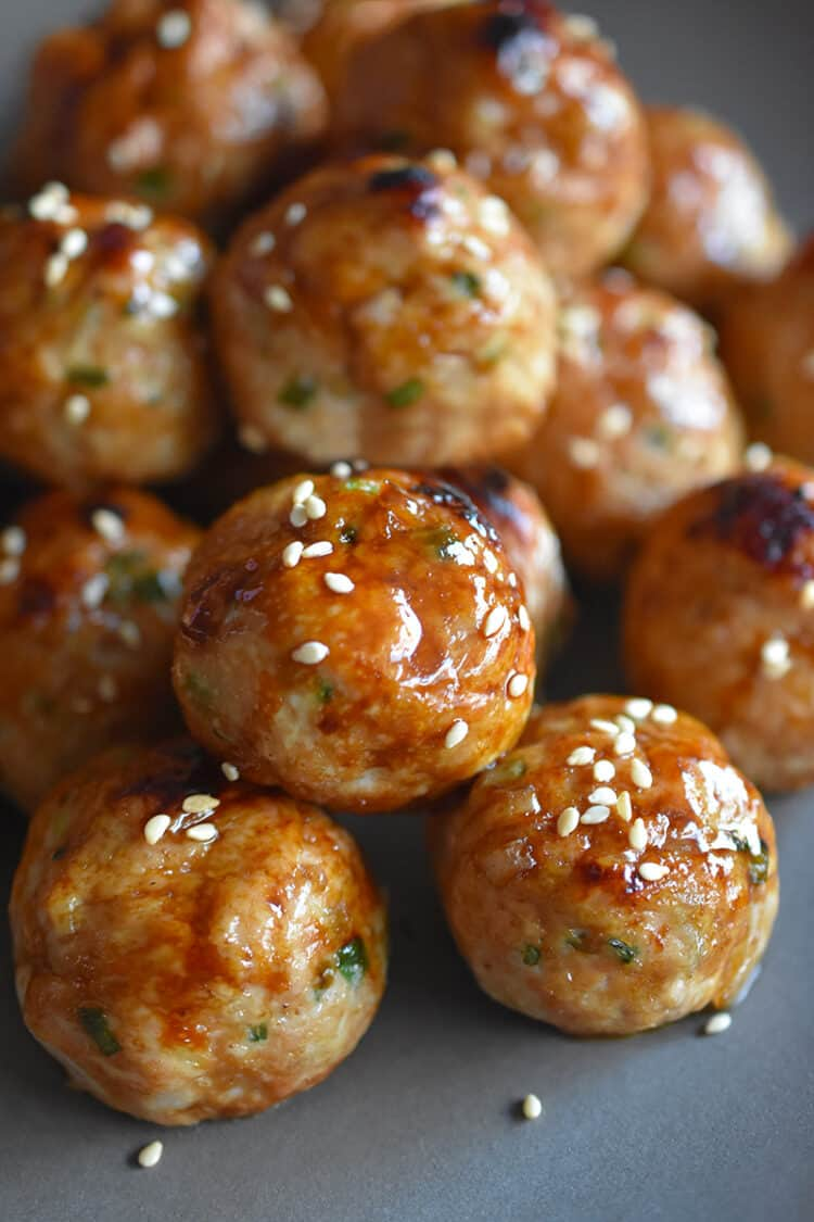A platter of Whole30 and Paleo-friendly tsukune, Japanese ground chicken meatballs.