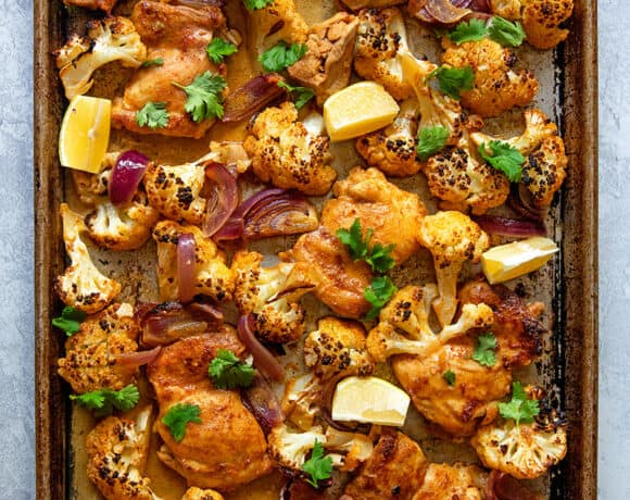 An overhead shot of healthy and easy sheet pan Chicken tandoori, a Whole30 and keto-friendly dinner!
