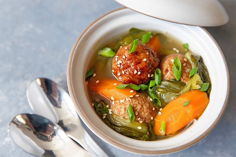 A bowl filled with Instant Pot Vegetable soup and meatballs.