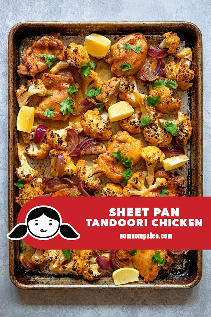 An overhead shot of quick and easy sheet pan tandoori chicken with cauliflower, a simple Whole30 and keto dinner.