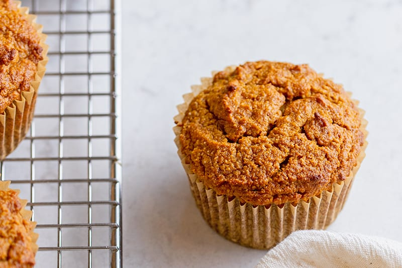 A closeup of paleo pumpkin muffins, an easy almond flour healthy treat.
