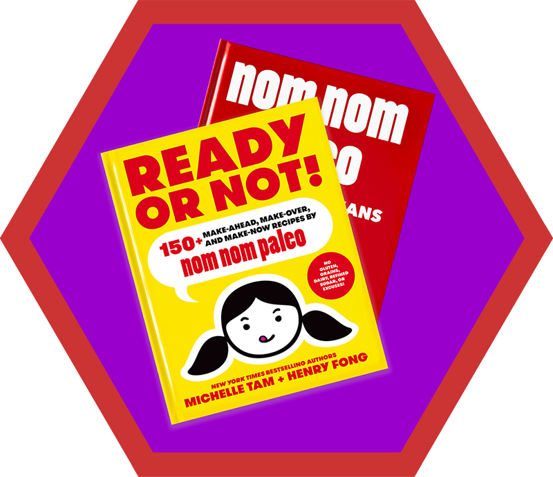 A copy of Ready or Not cookbook on top of a red Nom Nom Paleo cookbook