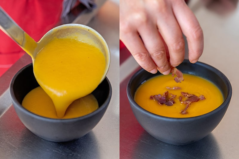 A black bowl is being filled with Instant Pot butternut squash soup. On the right the bowl of Whole30 soup is being topped with bacon bits and balsamic vinegar.